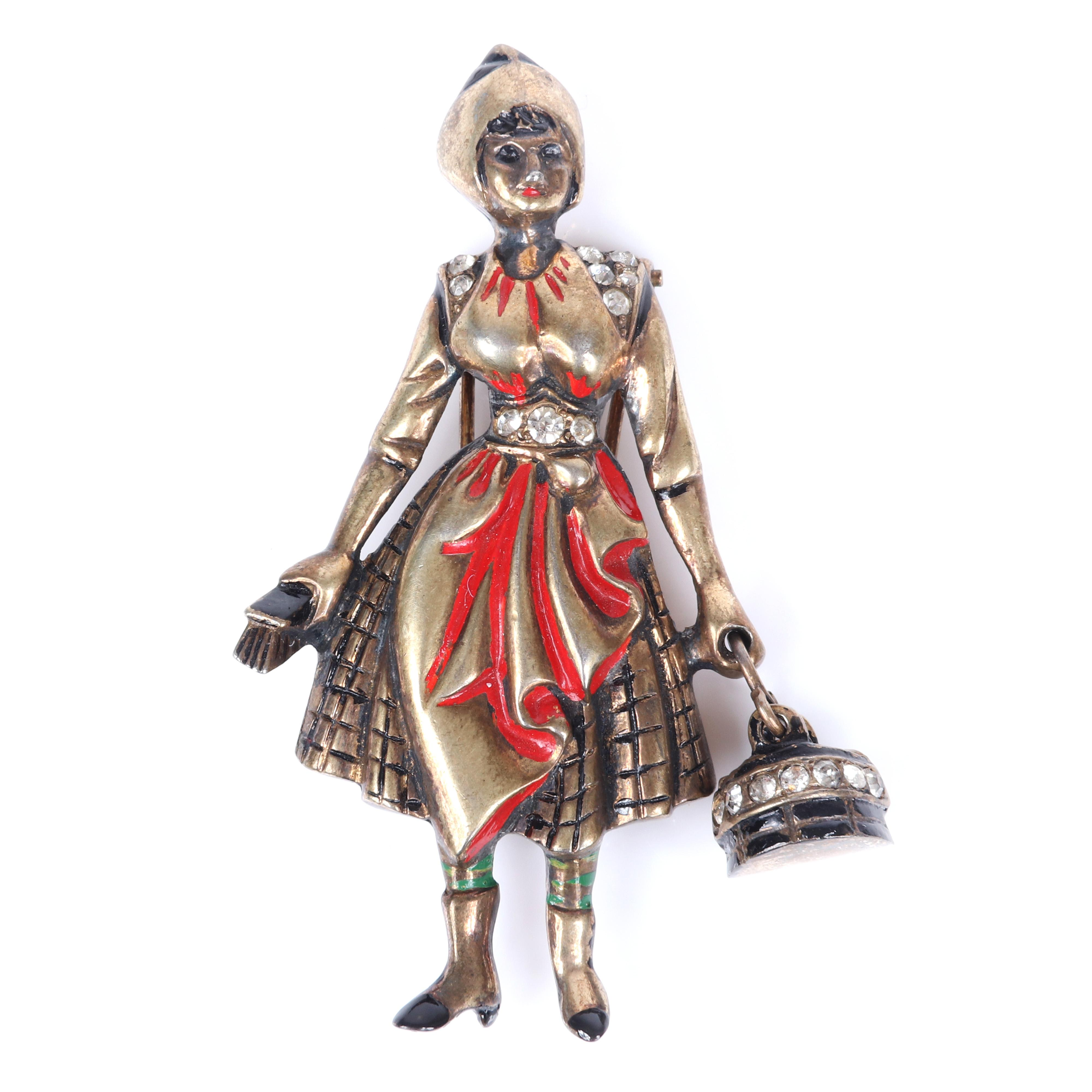 """Eisenberg Original sterling vermeil figural cleaning woman with bucket and brush figural pin clip with carved details, accented with red enamel and rhinestones, mid-1940s. 3 1/2"""" x 2"""""""