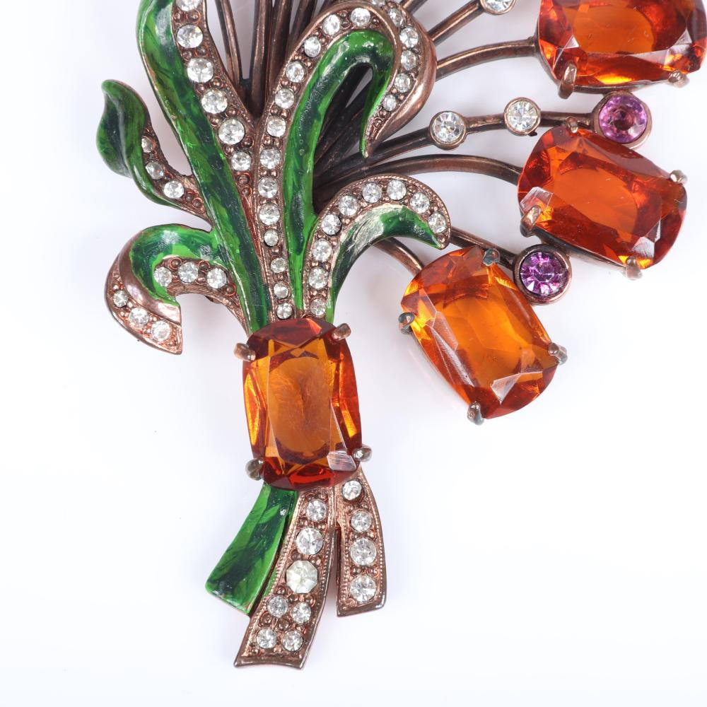 "Eisenberg Original huge flower bouquet with copper patina over pot metal, clear orange emerald-cut stones, bezel-set pink crystals, green enamel, pave, early 1940s. 4 3/4"" x 2 1/2"""