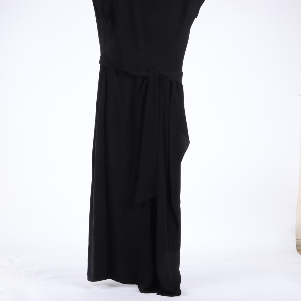 """Eisenberg Original black crepe cocktail dress with front draping, asymmetrical keyhole neckline outlined with elaborate, rust-colored beading, large sunburst & green stone center, 1940s. 48""""L"""