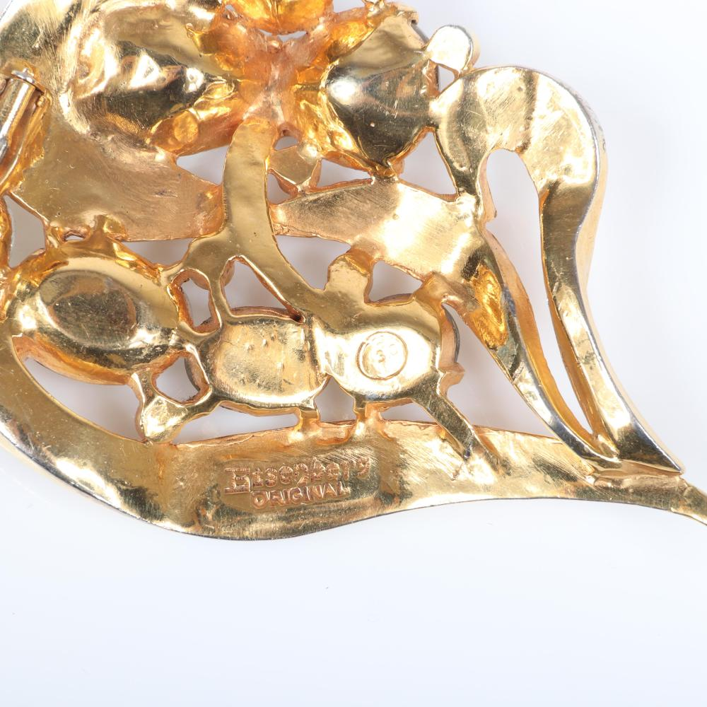 "Eisenberg Original abstract floral fur clip with curving gold washed leaves and oval and pear-set stones and bezel-set accent rhinestones, 1940s. 4"" x 2 1/2"""