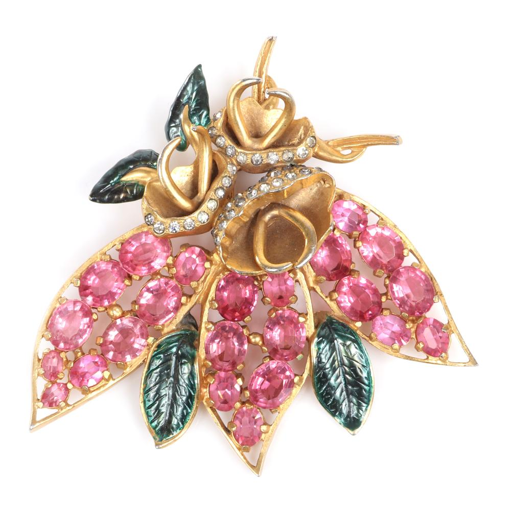 "Eisenberg Original floral fur clip with gold wash over pot metal, three gold buds with pave stones, open work petals with large pink crystals and green enamel leaves, early 1940s. 3 3/4"" x 3 3/4"""