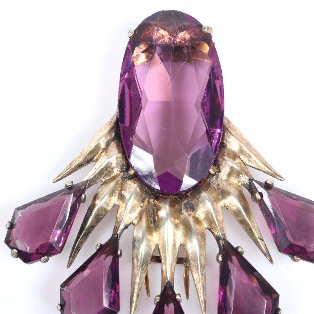 "Eisenberg Original sterling vermeil fur clip with large amethyst faceted central crystal stone and spikes dripping with amethyst teardrop stones, mid-1940s. 3"" x 2 1/2"""
