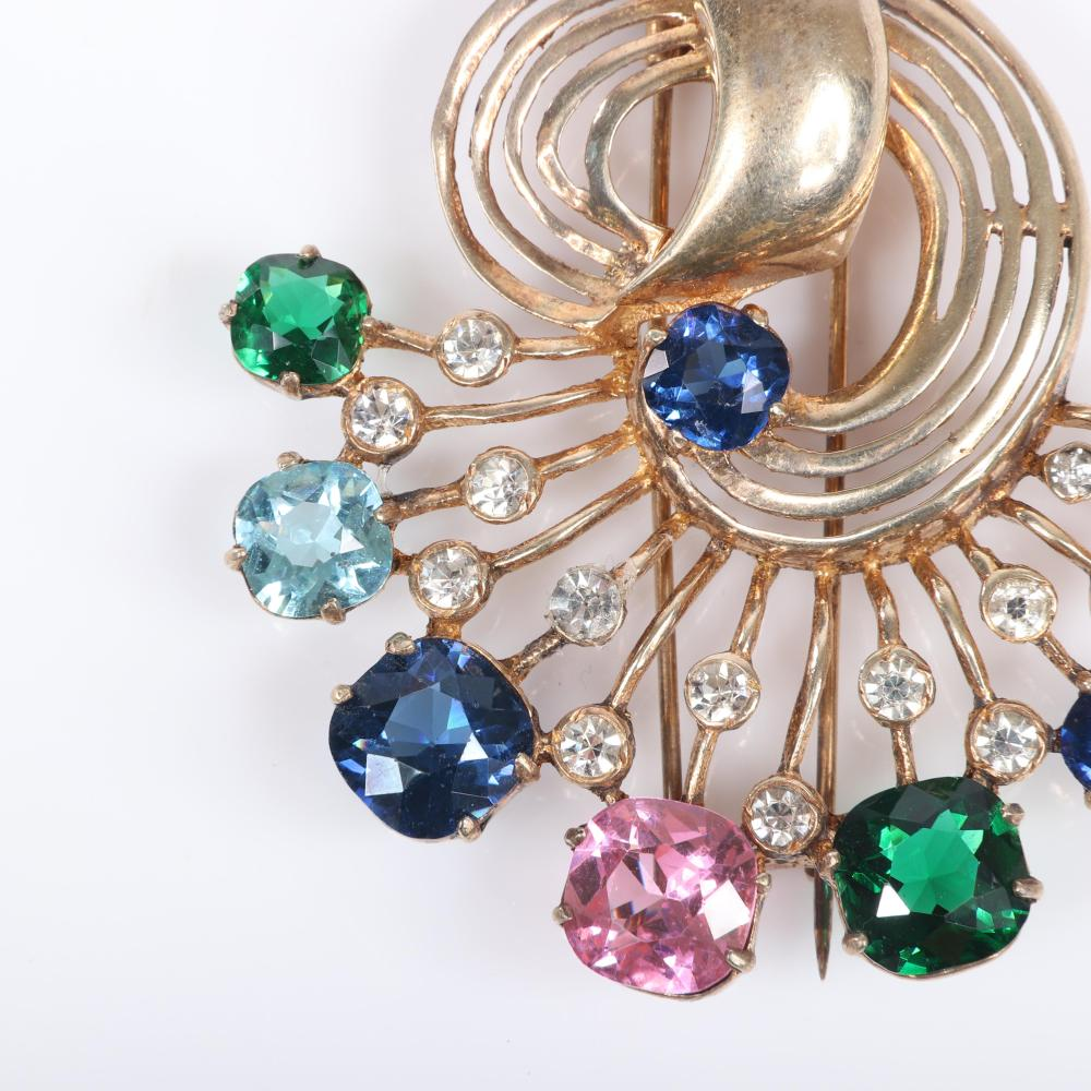 "Eisenberg Original colorful sterling vermeil swirling openwork fan fur clip with large graduated jewel tone crystals and clear bezel-set rhinestones, mid-1940s. 3"" x 3"""
