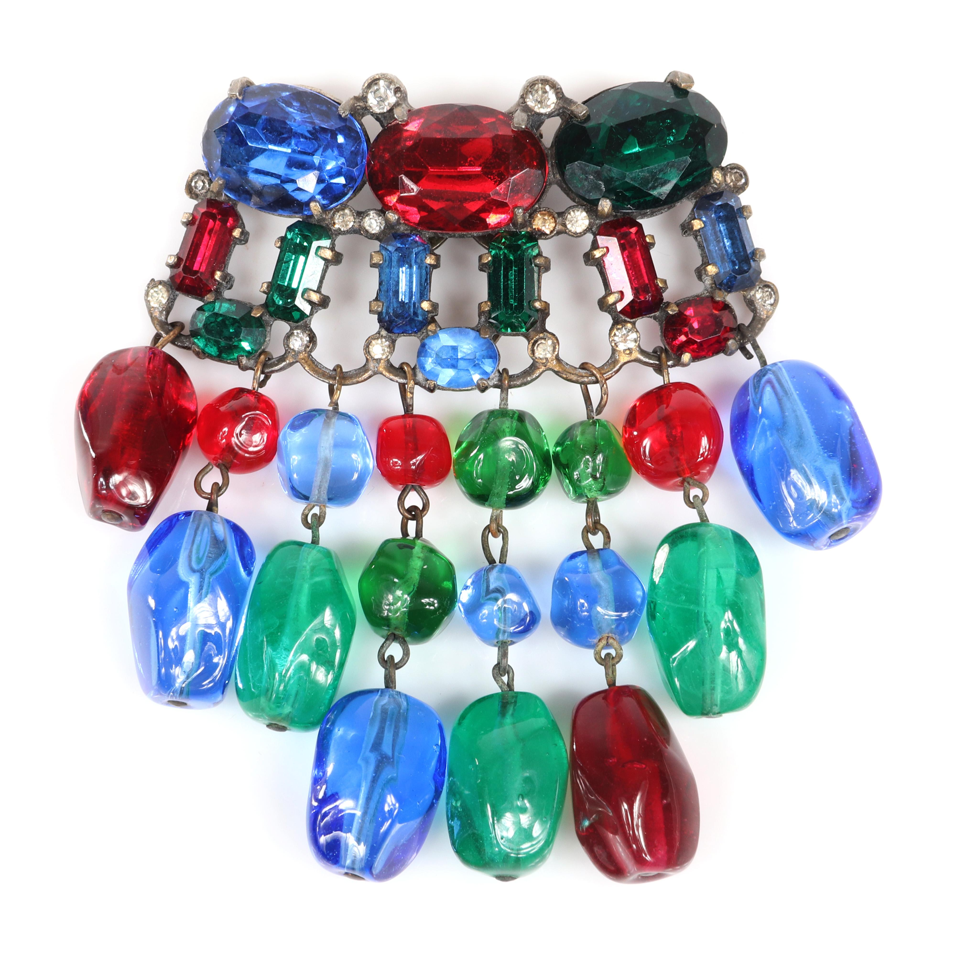 "Eisenberg Original unusual pot metal dress clip with red, green and blue faceted rhinestones, bezel-set clear accents and glass bead dangles, 1930s. 3"" x 2 1/2"""