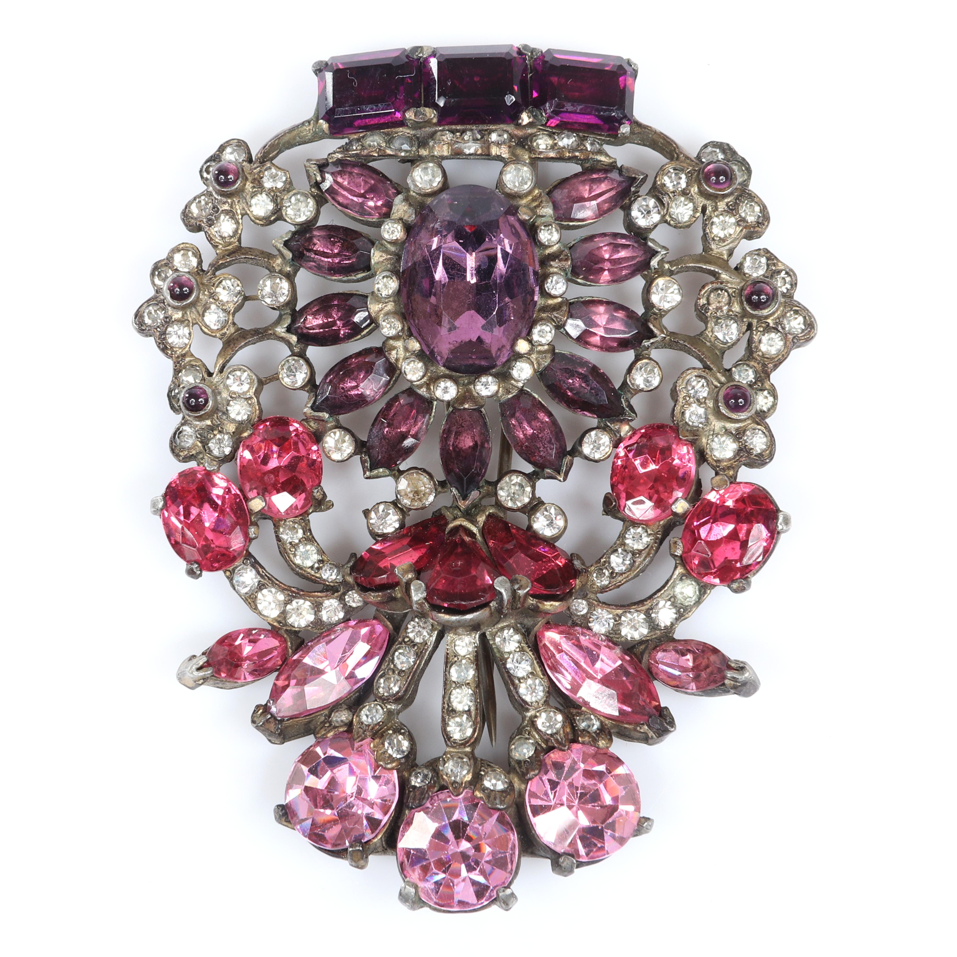 "Eisenberg Original sterling vermeil brooch with multi-hued pink blossom crystals in various sizes and cuts interspersed with bezel-set clear rhinestones, mid 1940s. 3 3/8"" x 2 3/4"""