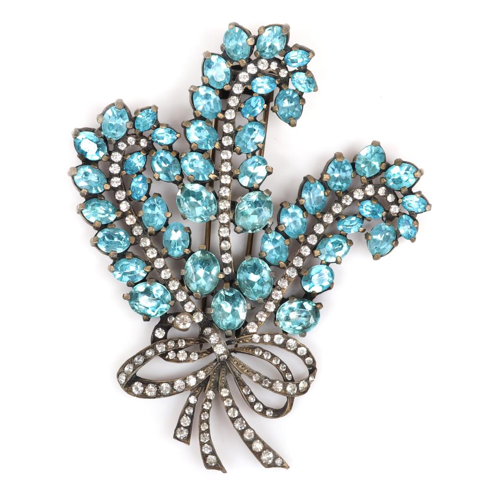 """Eisenberg Original aqua crystal tri-feather fur clip with pot metal & an impressive forty-one stones of tapering sizes and clear pave stones veining each feather & bow, early 1940s. 4"""" x 3 5/8"""""""