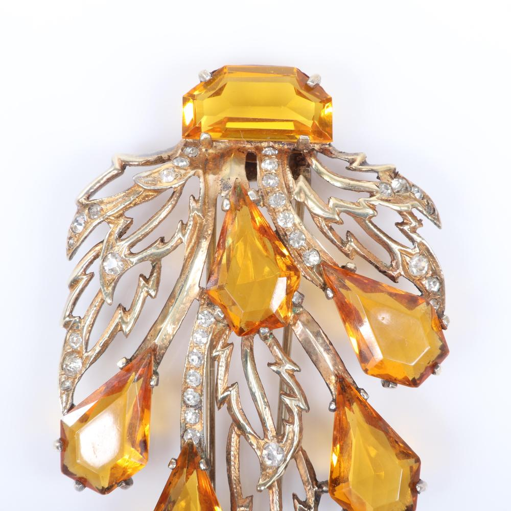 "Eisenberg Original topaz crystal fur clips with sterling vermeil openwork leaves and large open-backed topaz teardrop crystals and pave details, mid-1940s. 3"" x 2"""