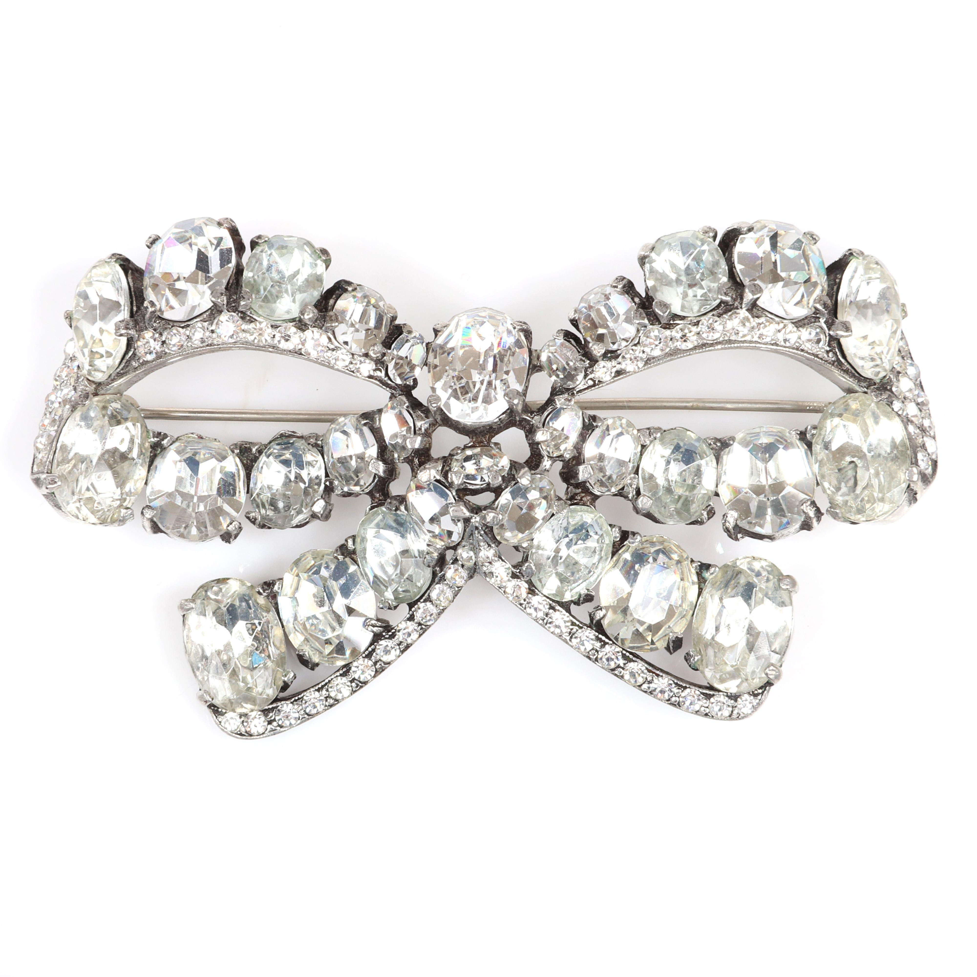 "Eisenberg Original large classic bow brooch with silver pot metal featuring large graduated oval clear crystals and pave, c. 1940. 2"" x 3 3/4"""