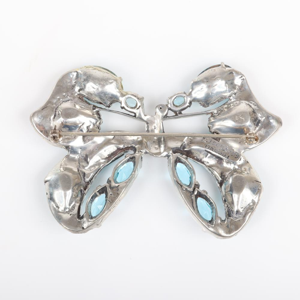 "Eisenberg Original openwork bow pin with massive aqua emerald-cut, oval, marquise and teardrop crystals and rhinestone details, 1940s. 2 1/4"" x 3 3/8"""