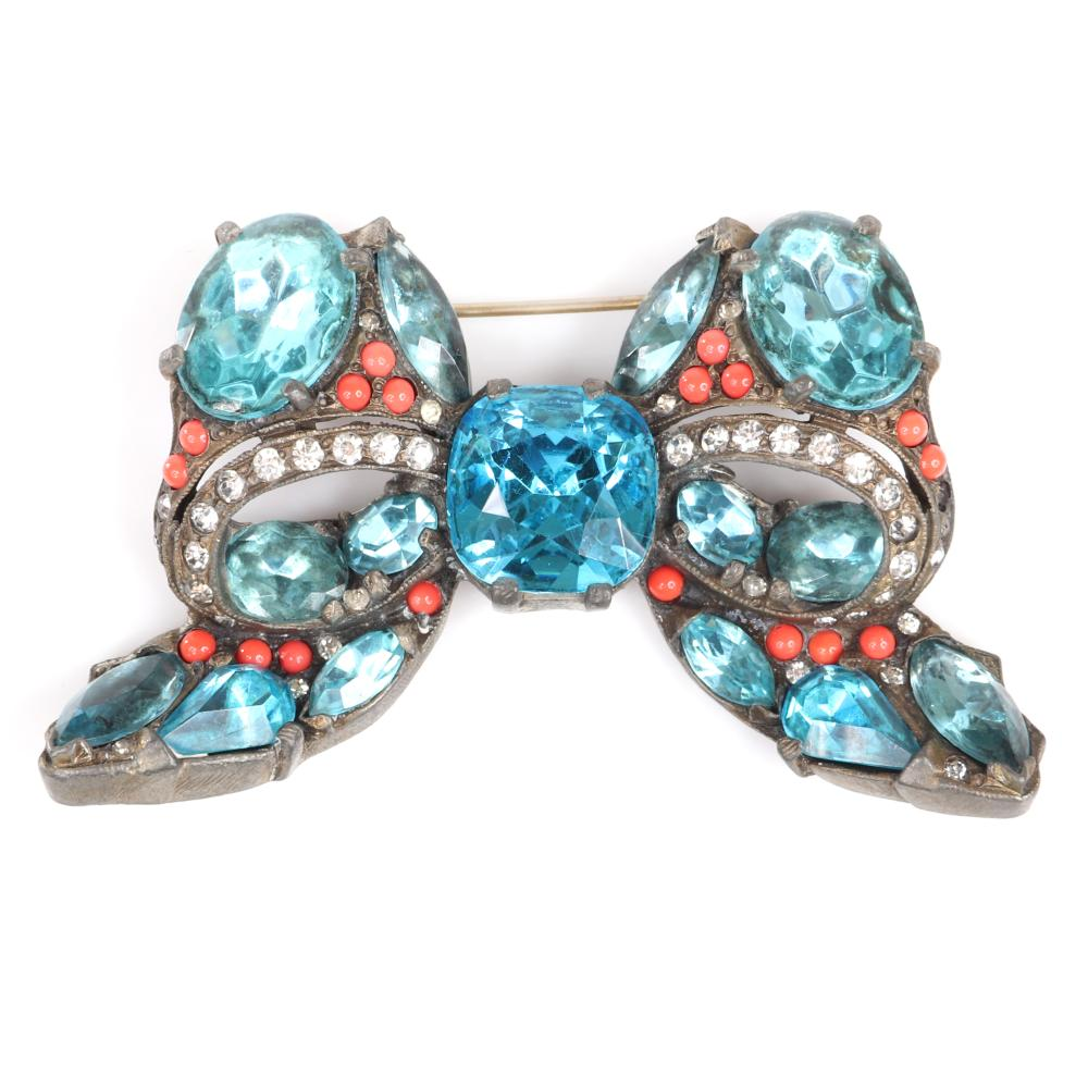 "Eisenberg Original bow brooch in gold wash over pot metal with huge aqua stones in various cuts, lines of clear pave and scattered faux coral beads, c. 1930s. 2 1/4"" x 3 3/8"""