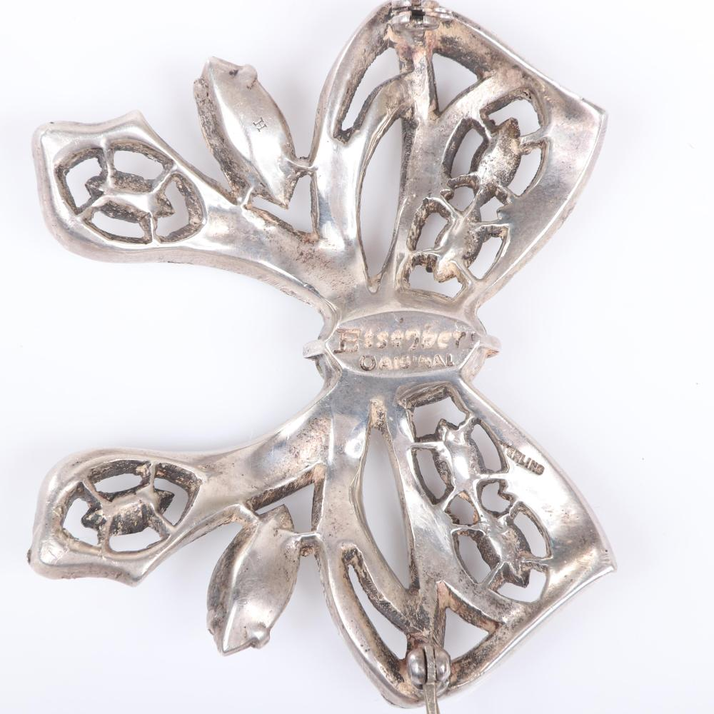"Eisenberg Original sterling bow brooch with layered strands of pave and open ribbon accented with clear marquise stones and large oval center crystal, mid-1940s. 2 5/8"" x 2 3/4"""