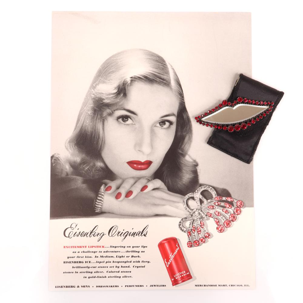 """Eisenberg Original lipstick mirror in the shape of lips, surrounded by faceted ruby crystals, includes original branded pouch, 1940s, with original 1943 Vogue advertisement. 1 1/2"""" x 3 1/2"""""""