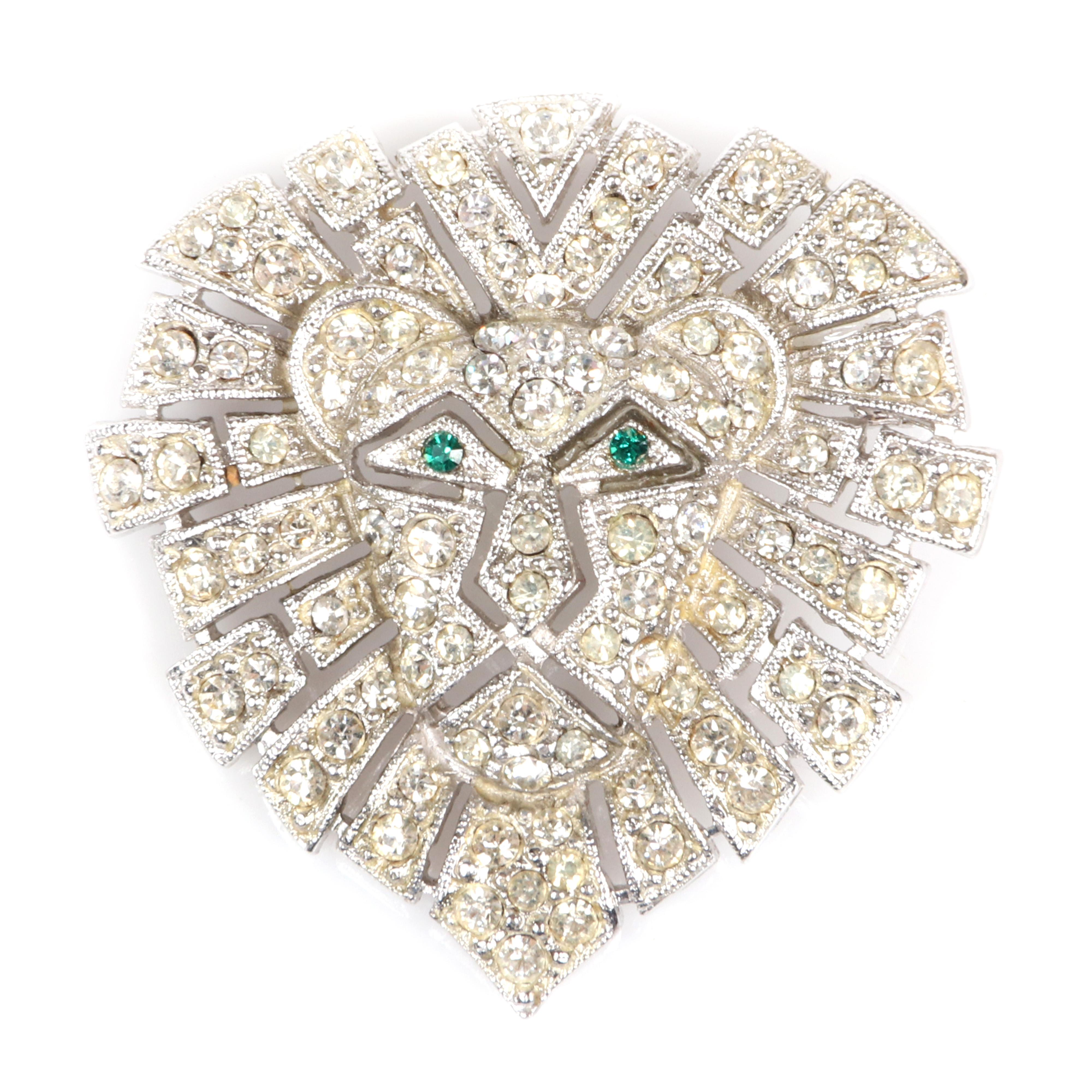 """Eisenberg Original rhodium plated lion's face brooch, marked Block E. with emerald rhinestone eyes and clear pave-set rhinestones, 1950s. 1 1/2"""" x 1 1/2"""""""