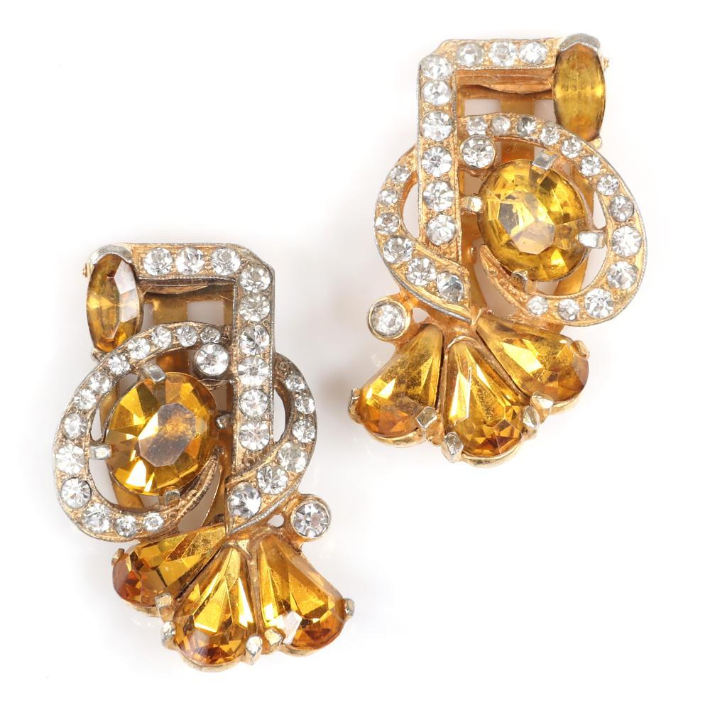 """Eisenberg Original pair of amber crystal dress clips in gold wash over pot metal with bright amber crystals in various shapes surrounded by pave stones, c. 1940. 1 3/4"""" x 1 1/4"""" (each)"""