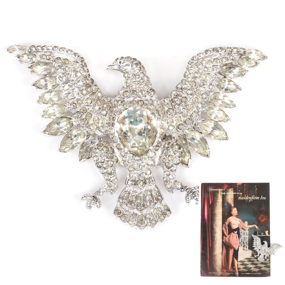 Rare Eisenberg iconic LARGE eagle brooch with rhodium base, bezel-set center stone, pave feathers, body and wings, and large navette stones on wing tips, c 1950s, page 156, figure 6.23. Includes original Maidenform 19...