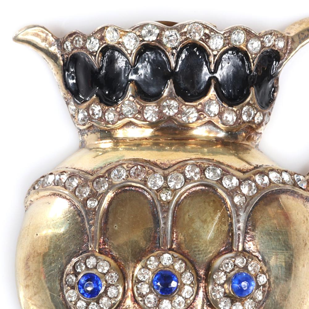 "Eisenberg Original sterling vermeil pitcher fur clip with black enameling tiny rhinestones and three small blue stones, advertised Christmas 1944. 2"" x 2"""