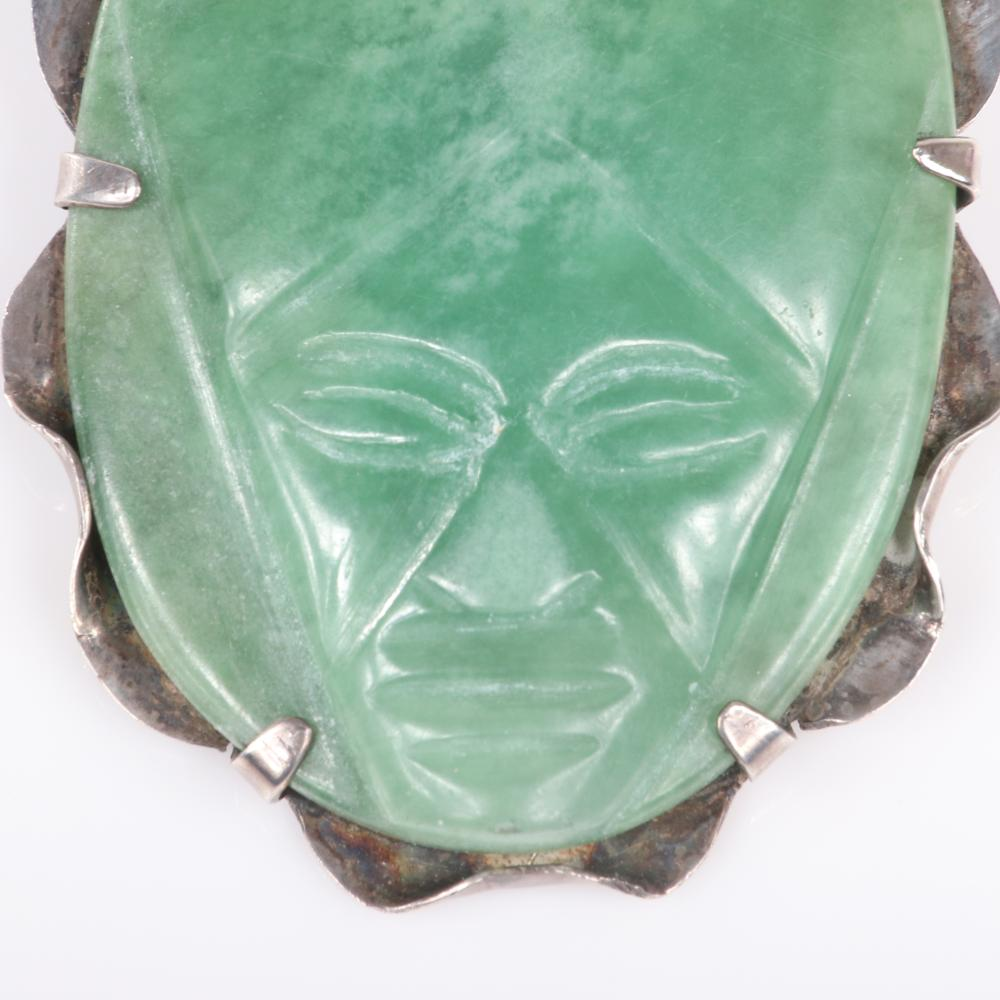 "Eisenberg Original Mexican sterling carved green onyx Aztec face brooch with sterling prong-set frame and hand-inscribed mark, mid-1940s. 2 1/2"" x 2"""