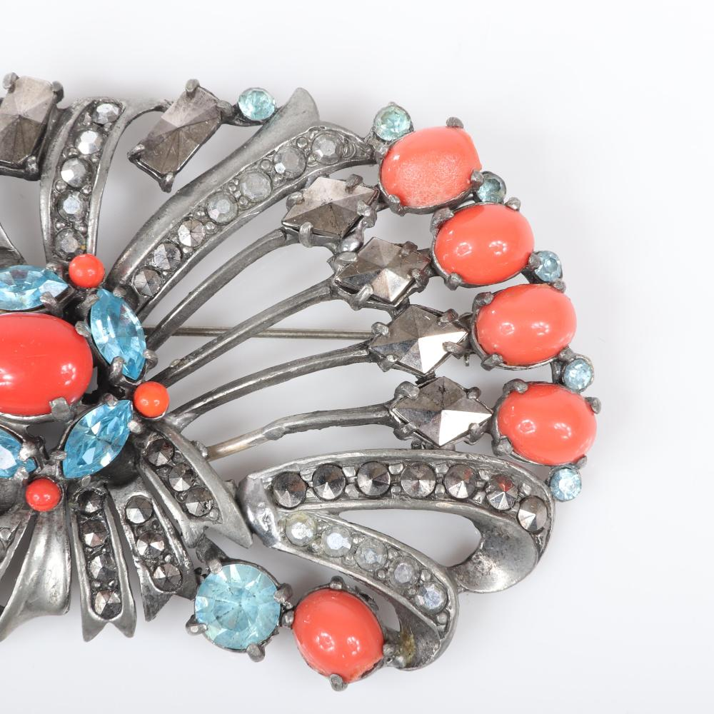 """Eisenberg Original fan brooch in silver pot metal with large rectangular and triangular prong-set marcasites with pave, orange cabochons and blue rhinestones, c. 1930s. 2 1/4"""" x 3 1/2"""""""