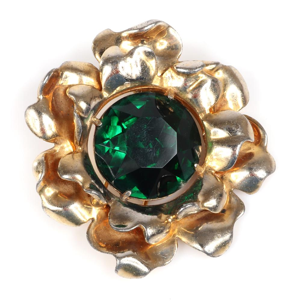 """Eisenberg Original floral fur clip with layered curled gold washed petals surrounding a huge emerald crystal stone, late 1930s. 2 1/2"""" diam., 7/8"""" diam. center stone"""