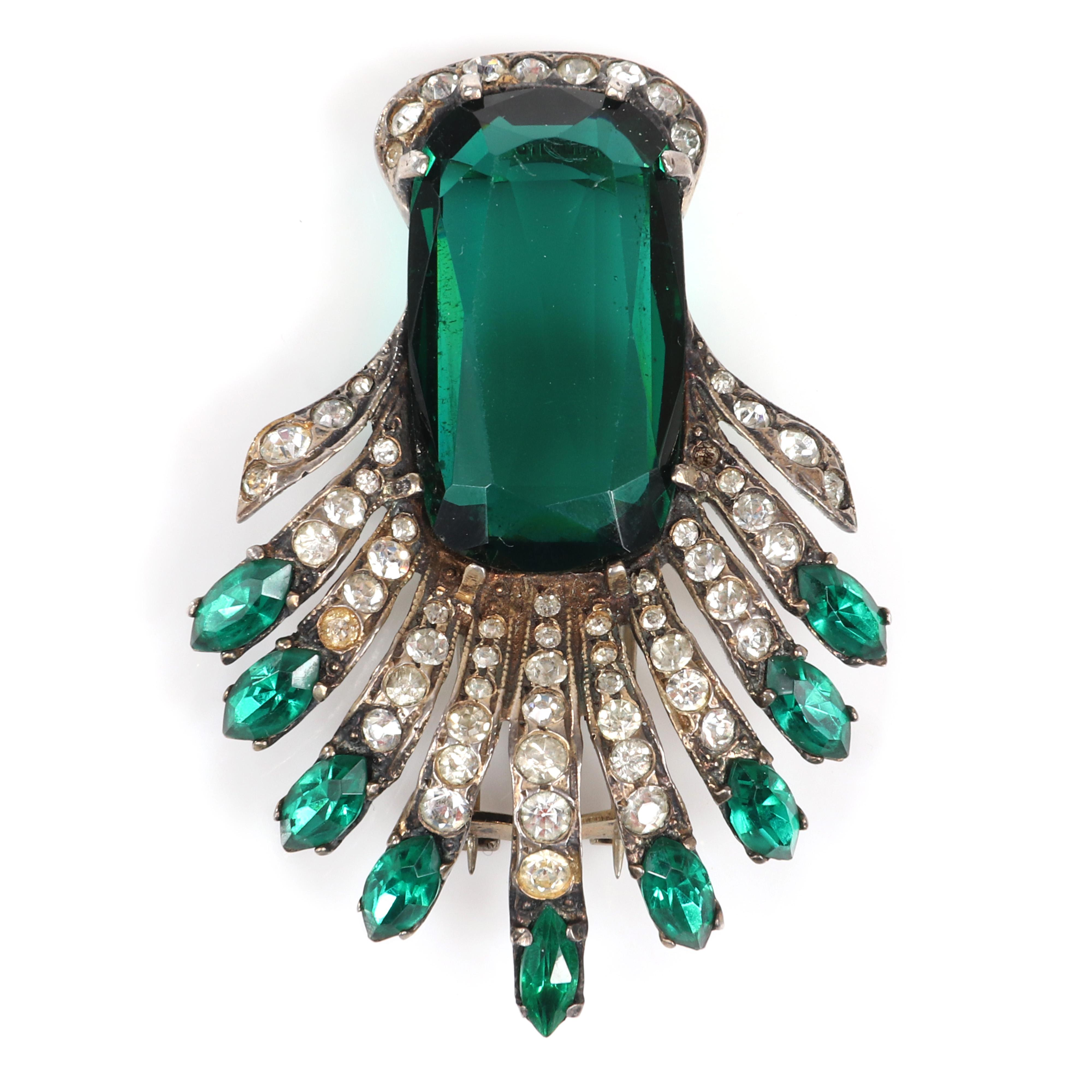 """Eisenberg Original Deco sterling fur clip with huge central emerald crystal stone and streamers of pave rhinestones tipped with emerald marquise crystals, c. 1944. 2 1/4"""" x 1 3/4"""""""