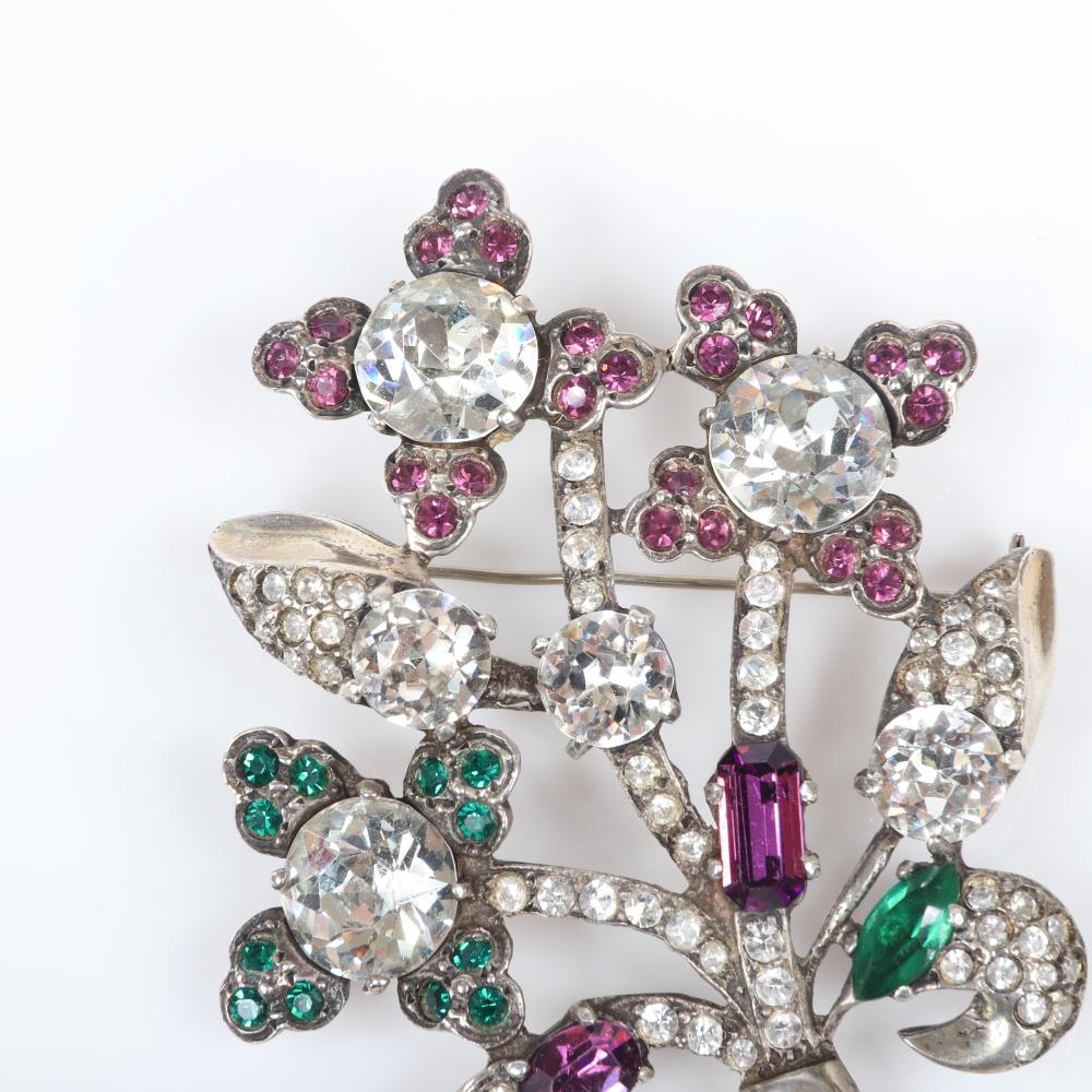 "Eisenberg Original sterling and multi-color floral bouquet brooch with large clear round rhinestones framed by petals of pastel stones, mid-1940s. 3"" x 2 1/2"""