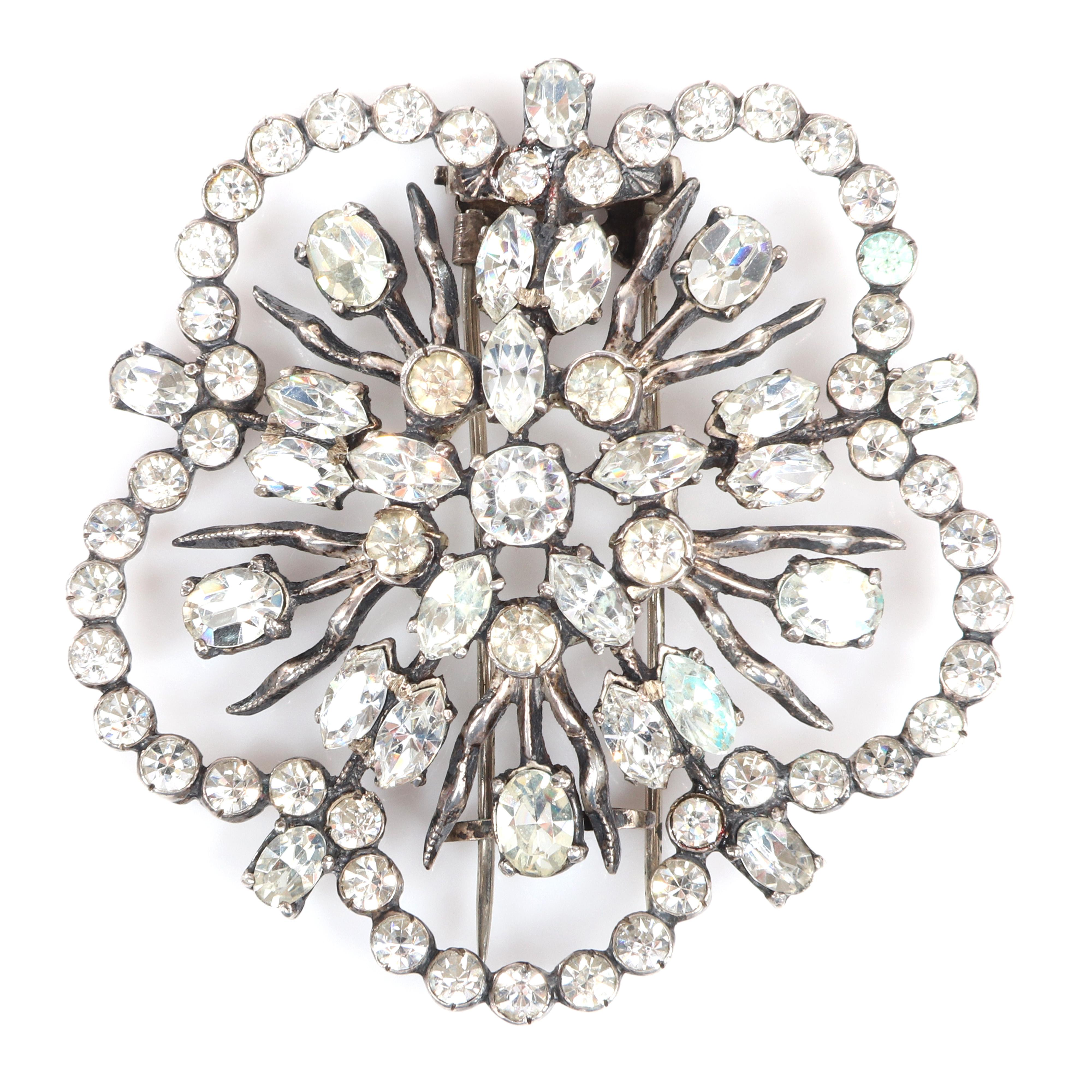 "Eisenberg Original sterling snowflake brooch with clear round, marquise and oval crystals and bezel-set rhinestones, mid-1940s. 2 1/2"" diam."
