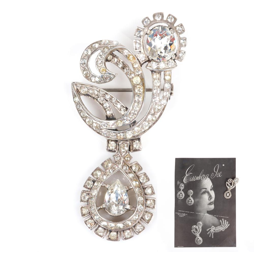 """Eisenberg Original sterling articulated brooch with swinging pear shaped pendant with bezel and pave-set rhinestones. Includes 1946 Vogue advertisement highlighting pin. 3"""" x 1 3/8"""""""