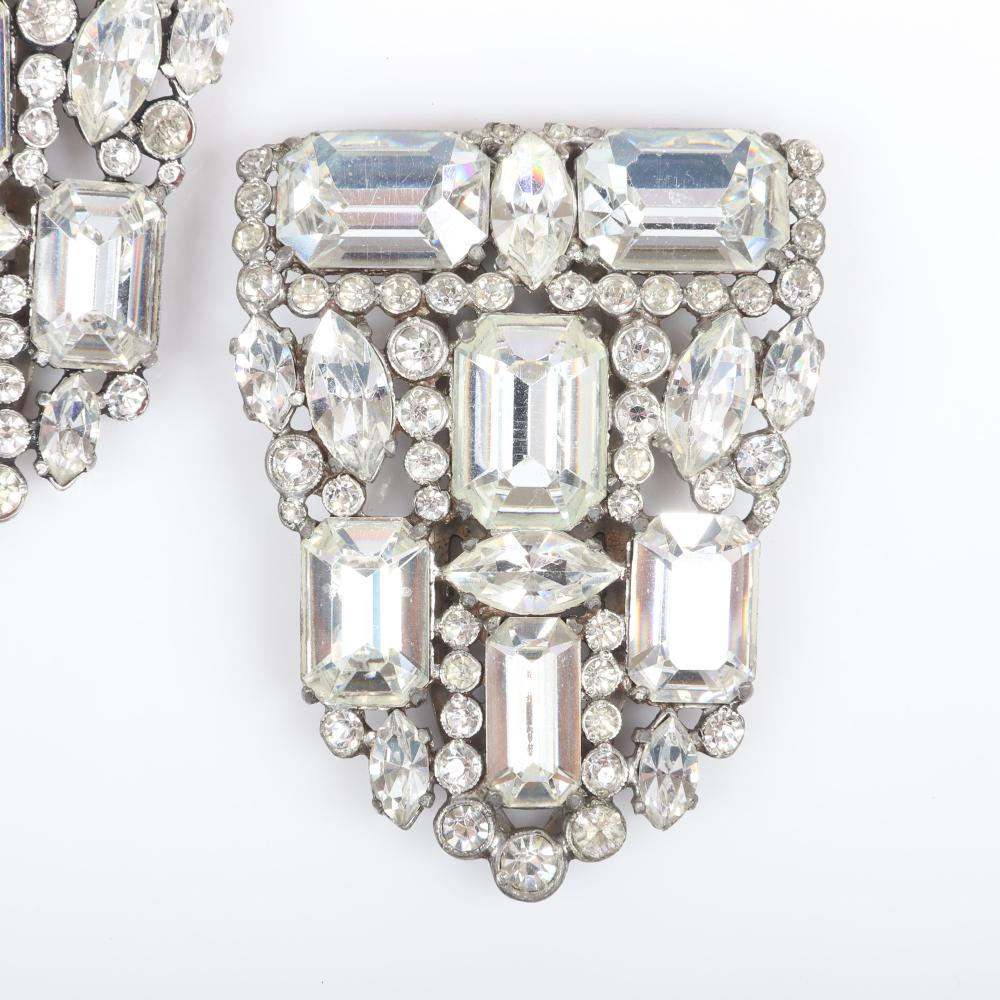 "Eisenberg Original arched dress clip with silver pot metal and two bezel-set rhinestones framing two large clear faceted crystals in different dimensions, late 1930s. 2 1/4"" x 3/4"""