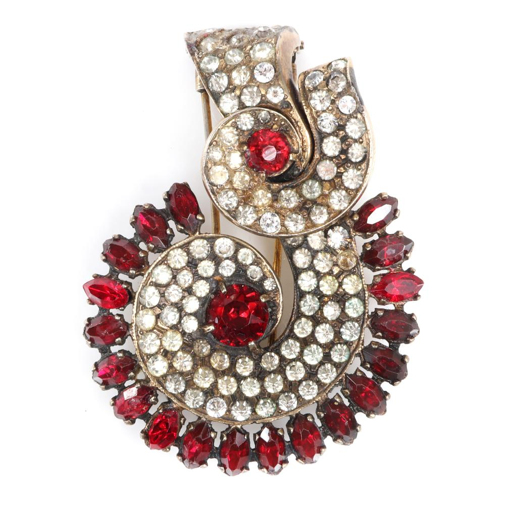 "Eisenberg Original sterling vermeil artistic scallop dimensional design fur clip with layered swirls of rhinestones accented with ruby rhinestones, 1940s. 2 1/2"" x 1 3/4"""