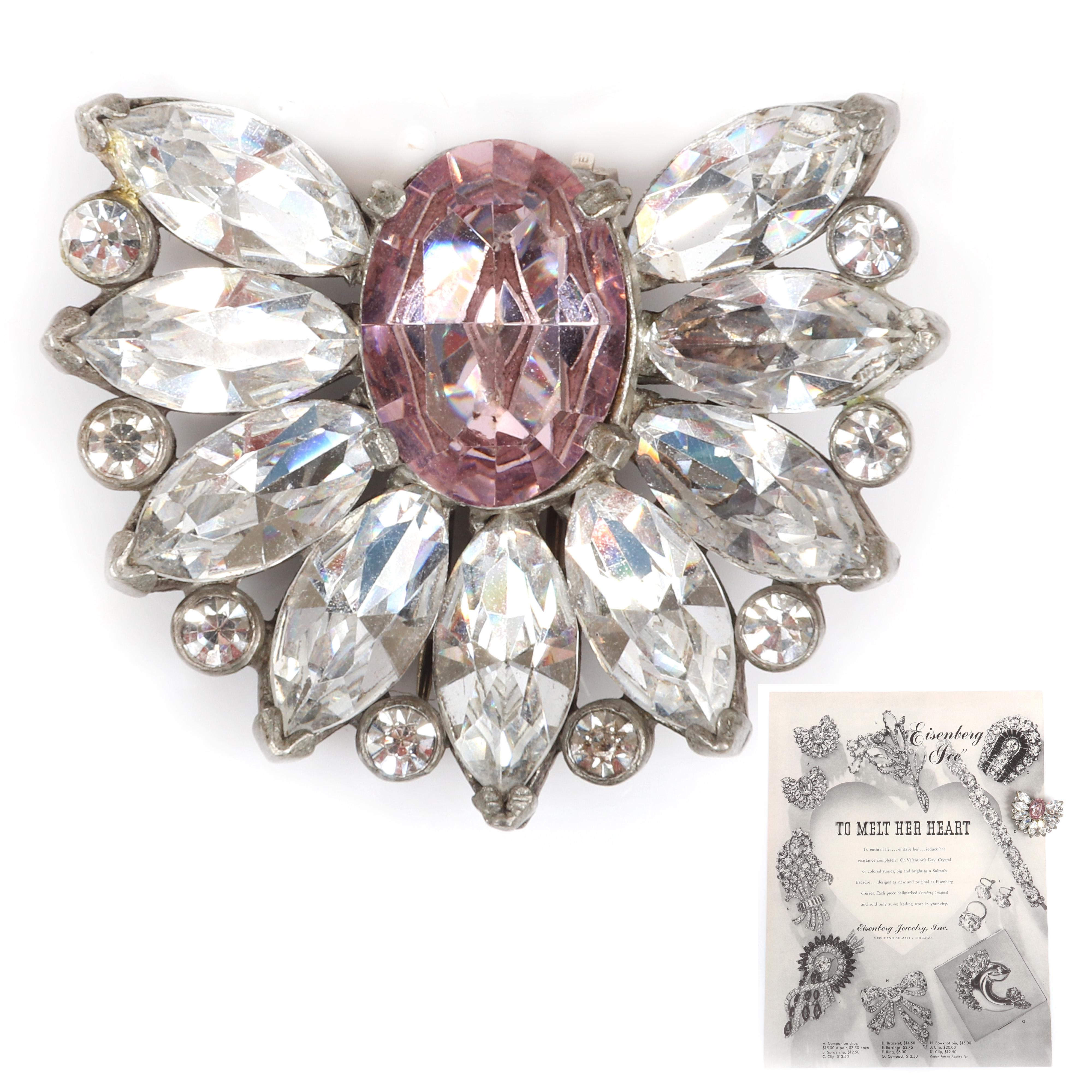 """Eisenberg Original floral fan dress clip with large central amethyst crystal surrounded by clear marquise & bezel-set rhinestones, c. 1942. Includes original 1946 Vogue advertising. 1 12"""" x 1 3/4"""""""