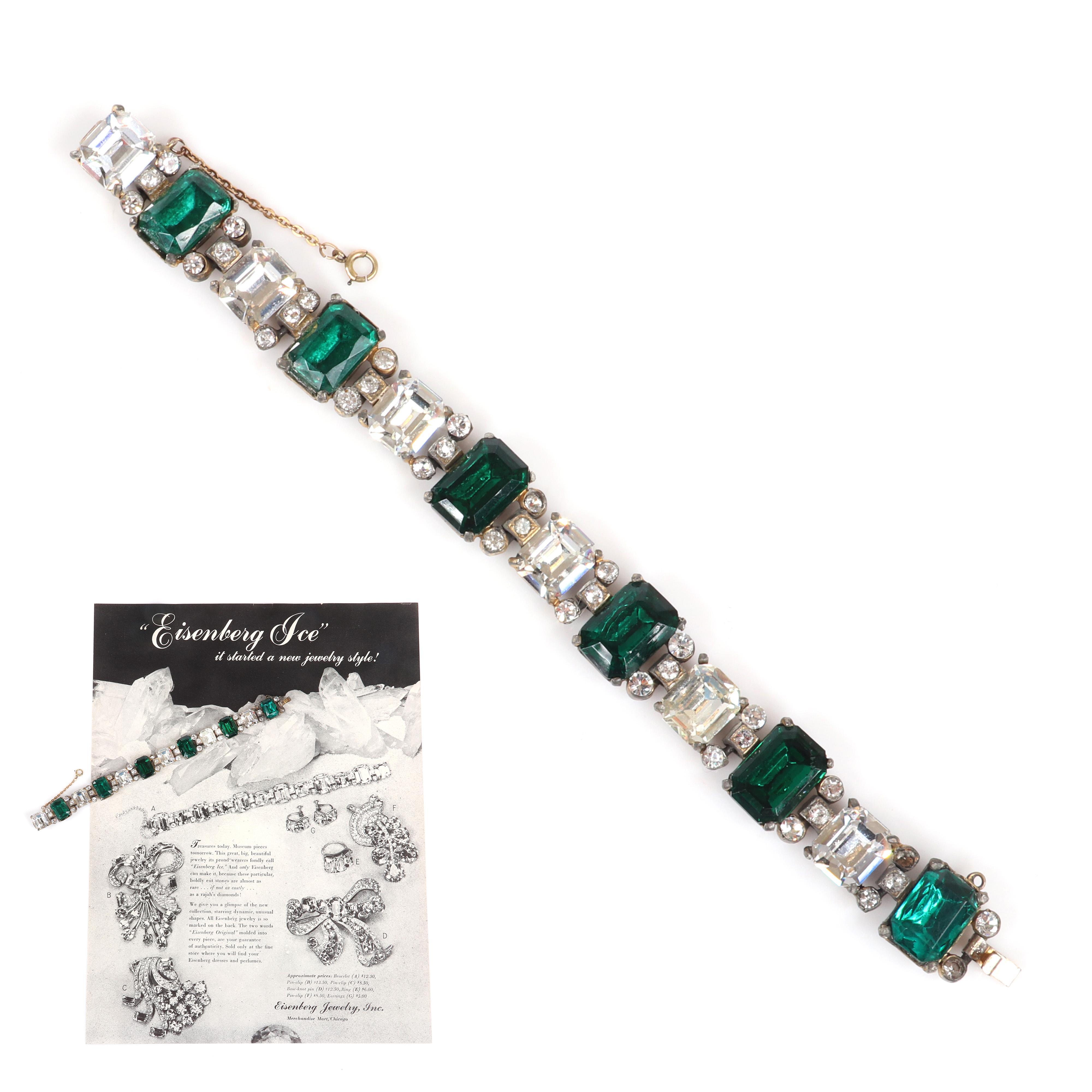 "Eisenberg Original crystal bracelet with gold pot metal & emerald-cut clear & green center stones. Includes original advertisement highlighting a version of this bracelet, c. 1942. 7 1/2""L x 5/8""W"