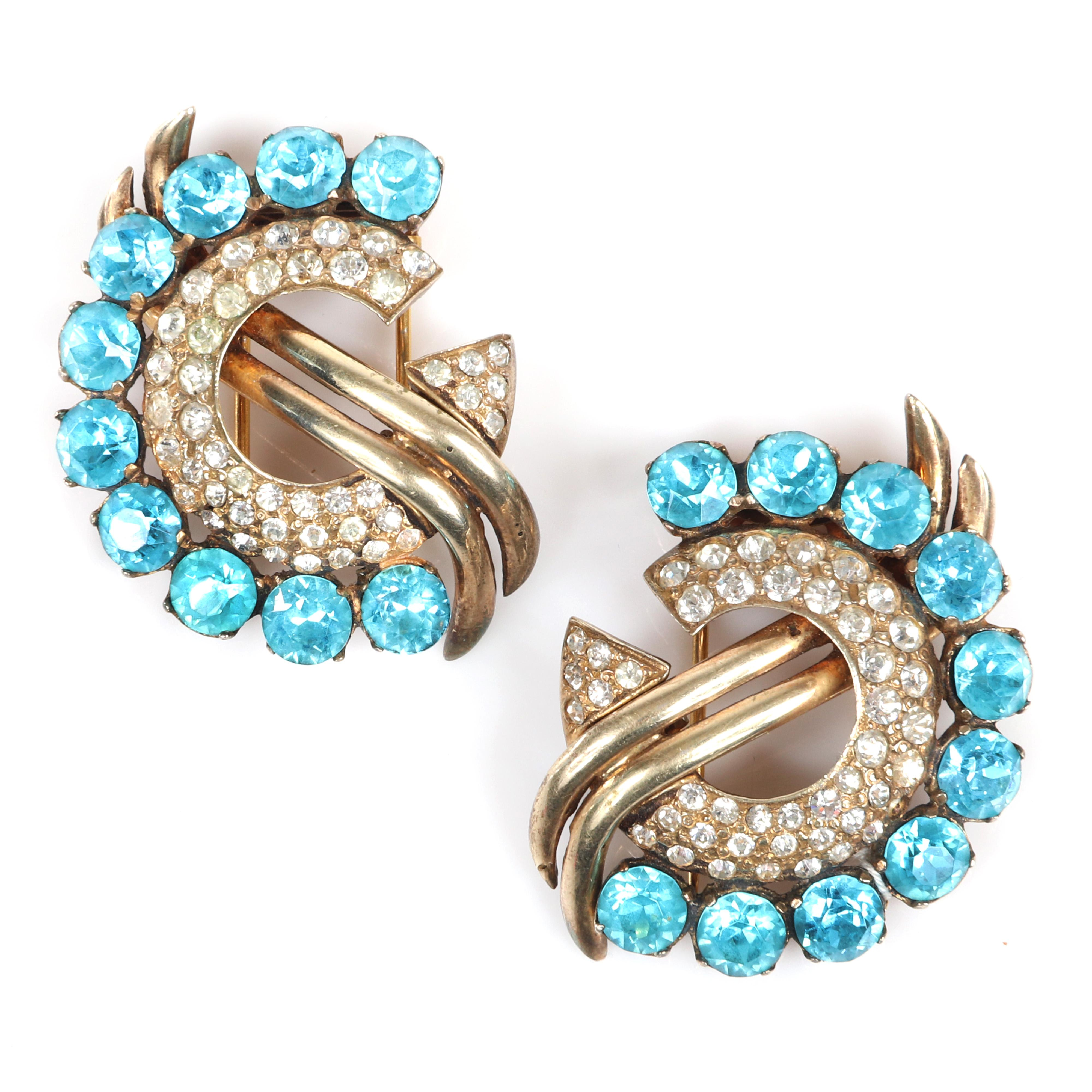 """Eisenberg Original pair of curving fur clips with gold wash over pot metal. clear pave and round aqua faceted rhinestones, c. 1940. 1 3/4"""" x 1 1/2"""""""