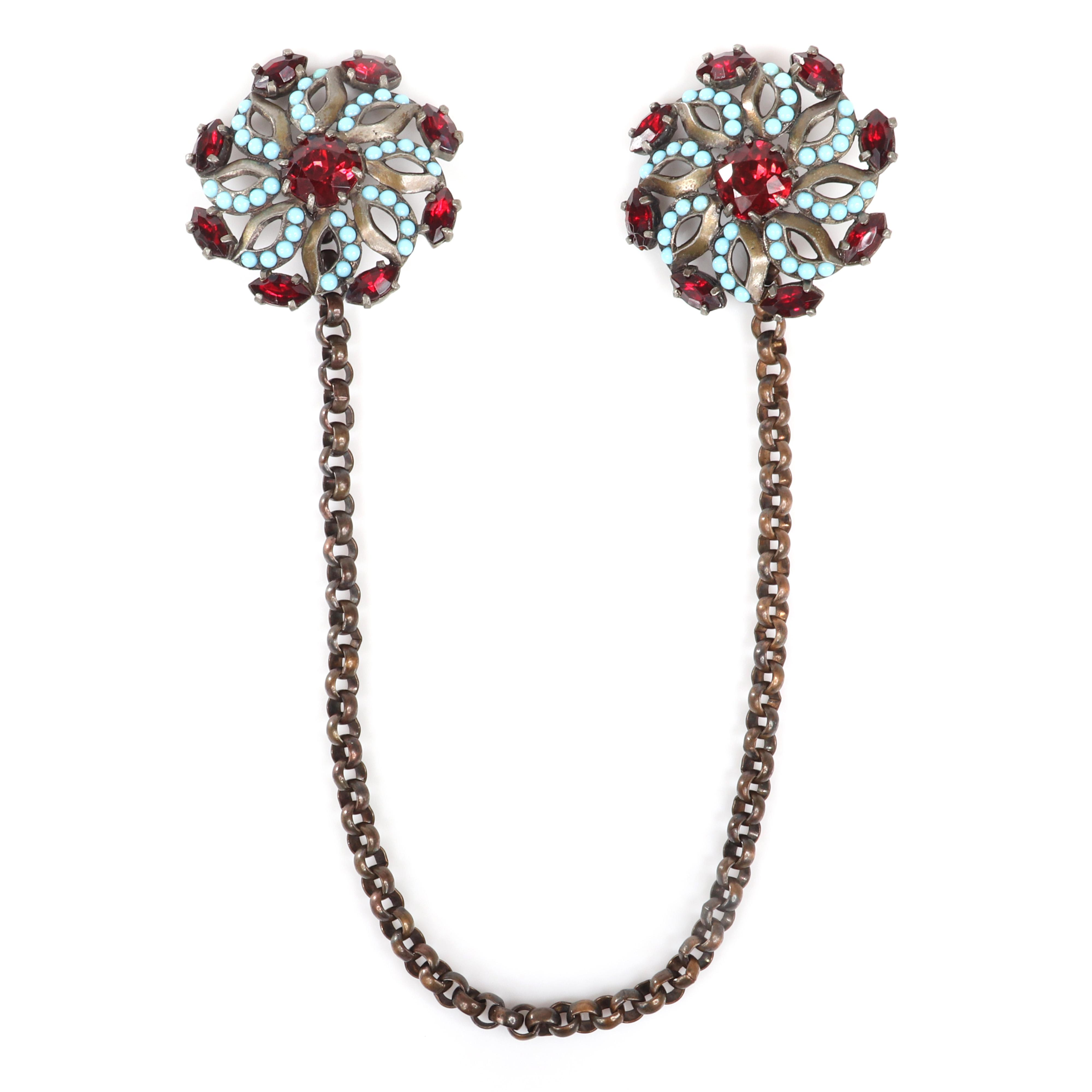 """Eisenberg Original unmarked linked dress adornment chatelaine with two pinwheel sew-ons with faux turquoise beads and ruby faceted crystals, with setter's mark, c. 1930s. 2"""" diam (each adornment), 12""""L (chain)"""