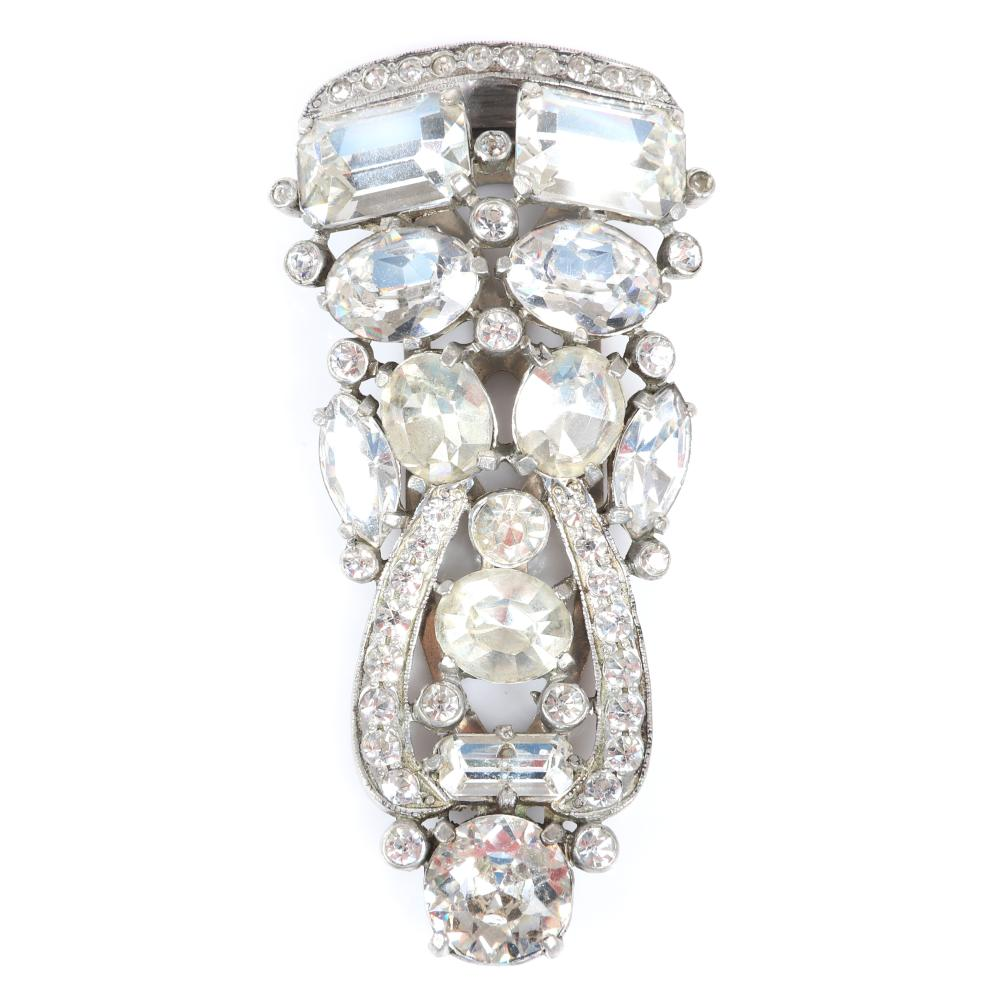"Eisenberg Original scrolling elongated diamante fur clip with silver pot metal, large emerald, oval & marquise cut stones. Includes 1940 original Vogue magazine advertisement. 3 1/4"" x 1 1/2"""
