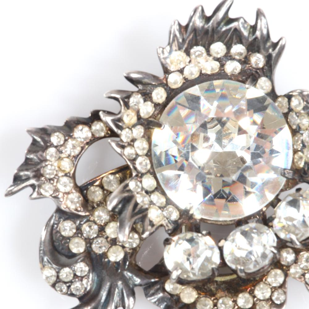 """Eisenberg Original sterling three-dimensional diamante floral fur clip with large central crystal surrounded by layers of bezel-set rhinestones, mid-1940s. 2 1/2"""" x 2"""""""