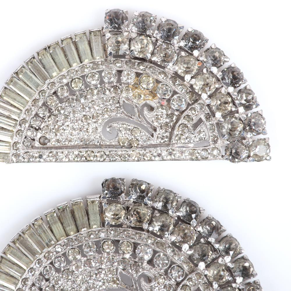 "Eisenberg Original unique diamante half-circle shoe clips with pave, graduated bezel-set rhinestones and smoky gray crystals, marked Block E., c 1950. 1 1/8"" x 1 7/8"""