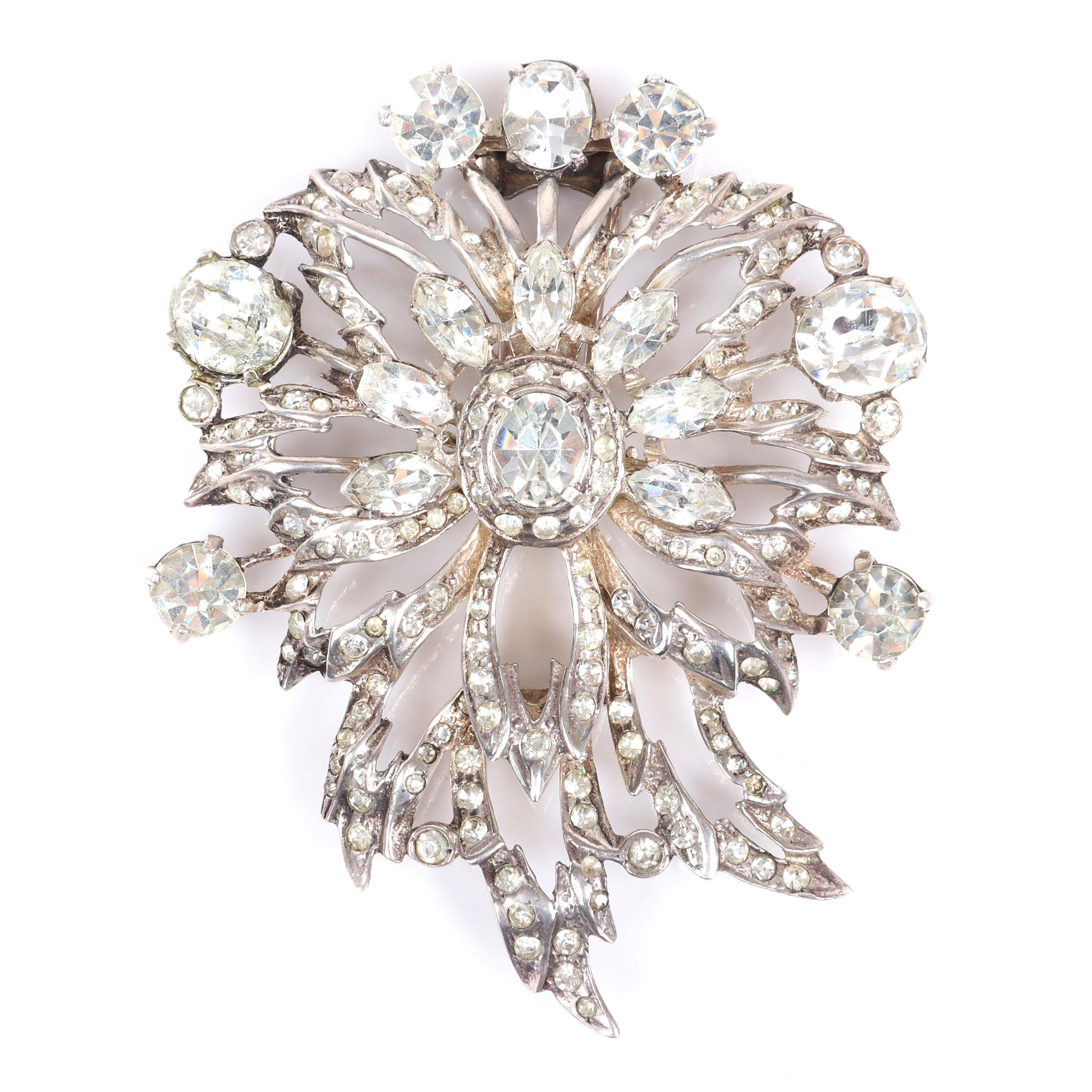 """Eisenberg Original large abstract diamante and openwork fur clip with large central oval crystal, pave, marquise and round faceted rhinestones, mid-1940s. 3"""" x 2 1/4"""""""