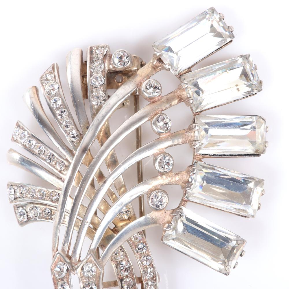 "Eisenberg Original sterling floral dress clip with arching stems and five large emerald cut crystals, bezel-set rhinestones and pave, c. mid-1940s. 3"" x 2 1/4"""