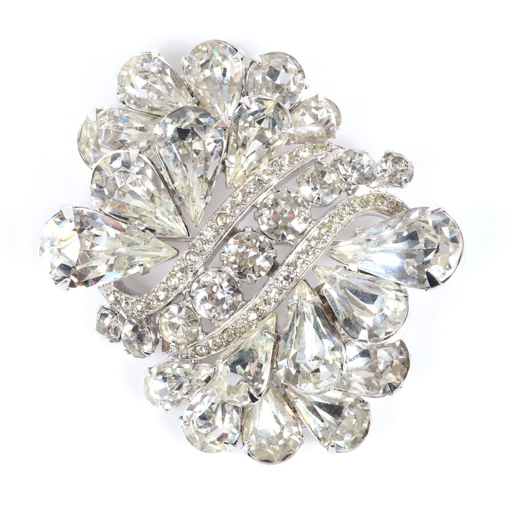 """Eisenberg Ice bouquet of teardrops brooch with dimensional rows of teardrop rhinestones and a center section of large round stones, marked Block Eisenberg, c. 1950s, includes original Vogue 1956 advertisement. 2"""" x 2 ..."""