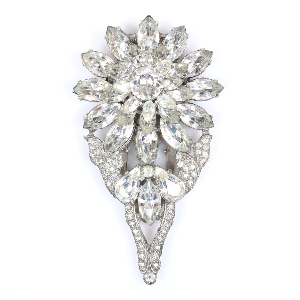 """Eisenberg Original dimensional floral dress clip with silver pot metal, pave and layers of marquise cut crystals surrounding a round central faceted stone, c. 1940. 3 1/2"""" x 2"""""""