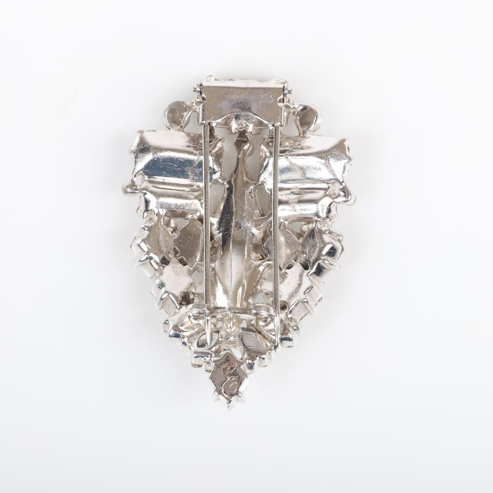 "Eisenberg Original abstract triangular fur clip with silver pot metal and a variety of stone cuts including pear, marquise, round and oval and clear pave sets c. 1940. 3 1/8"" x 3 3/4"""