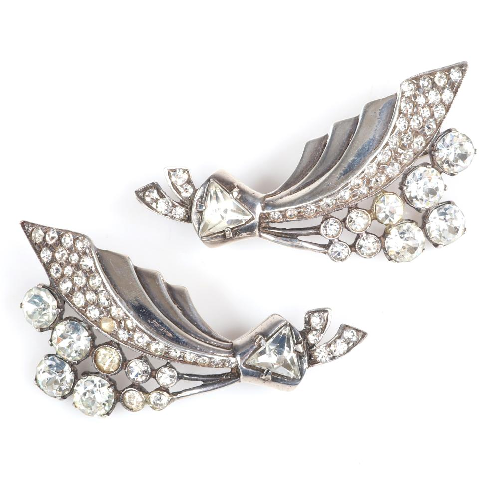 "Eisenberg Original pair of sterling flower spray brooches with graduated clear round and bezel-set rhinestones and pave along leaf and stems and large triangular crystals, c. 1943. 2 1/4"" x 2 1/4"""