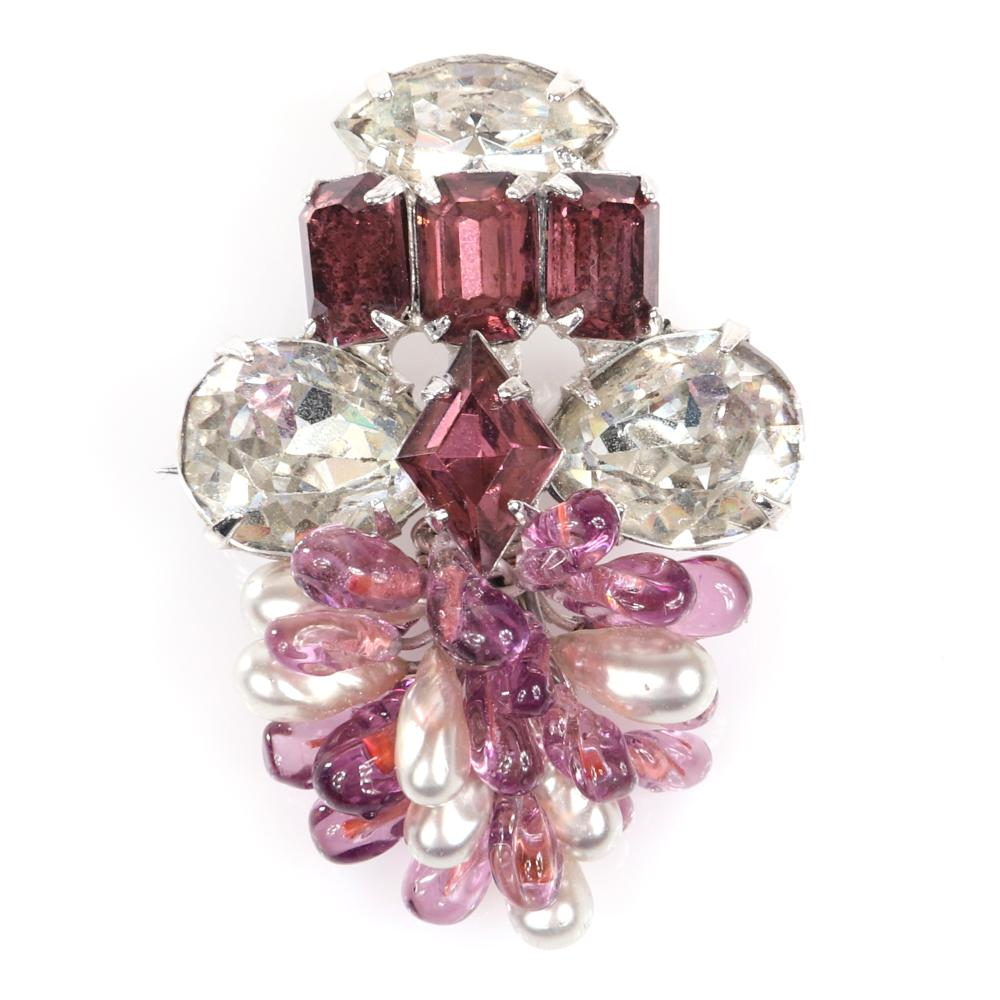 """Eisenberg Ice two brooches: mauve & clear rhinestone brooch with a cluster of art glass & faux pearl beads and diamante fur clip with large oval, marquise & triangle crystals, 1950s. 1 1/2""""H (mauve), 1 3/4""""H (diamante)"""