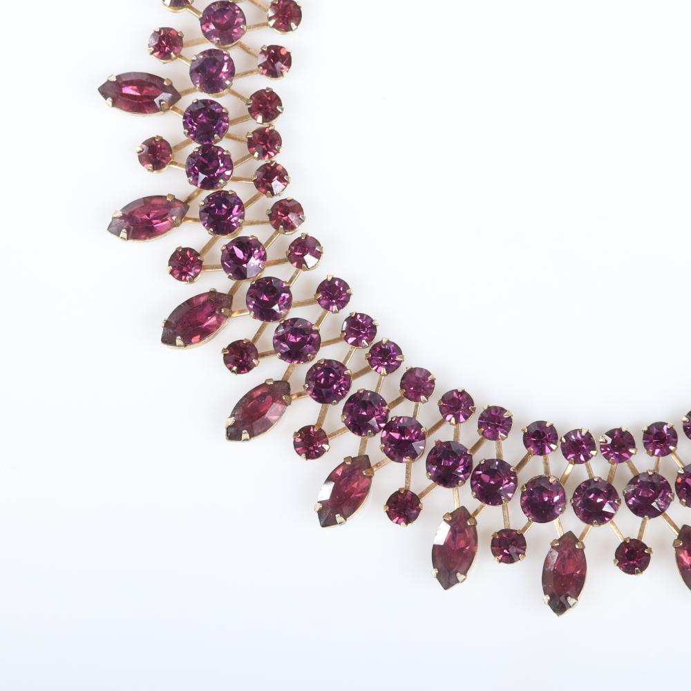 """Eisenberg amethyst crystal choker necklace with gold crosshatch framework and three rows of rhinestones and marquise drops at the bottom, late 1940s. 14 1/2""""L x 1 1/4""""W"""