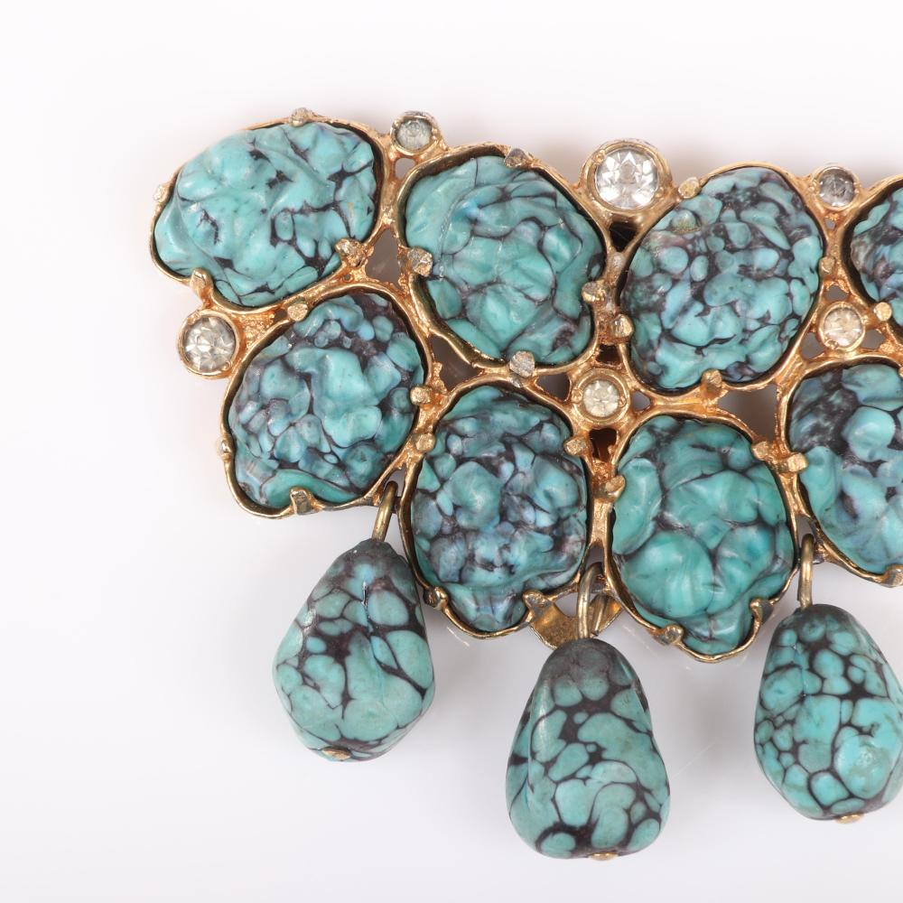 "Eisenberg unsigned gold pot metal dress clip with faux turquoise molded glass nuggets and dangles and bezel-set rhinestones, c. 1930s. 2"" x 2 1/8"""