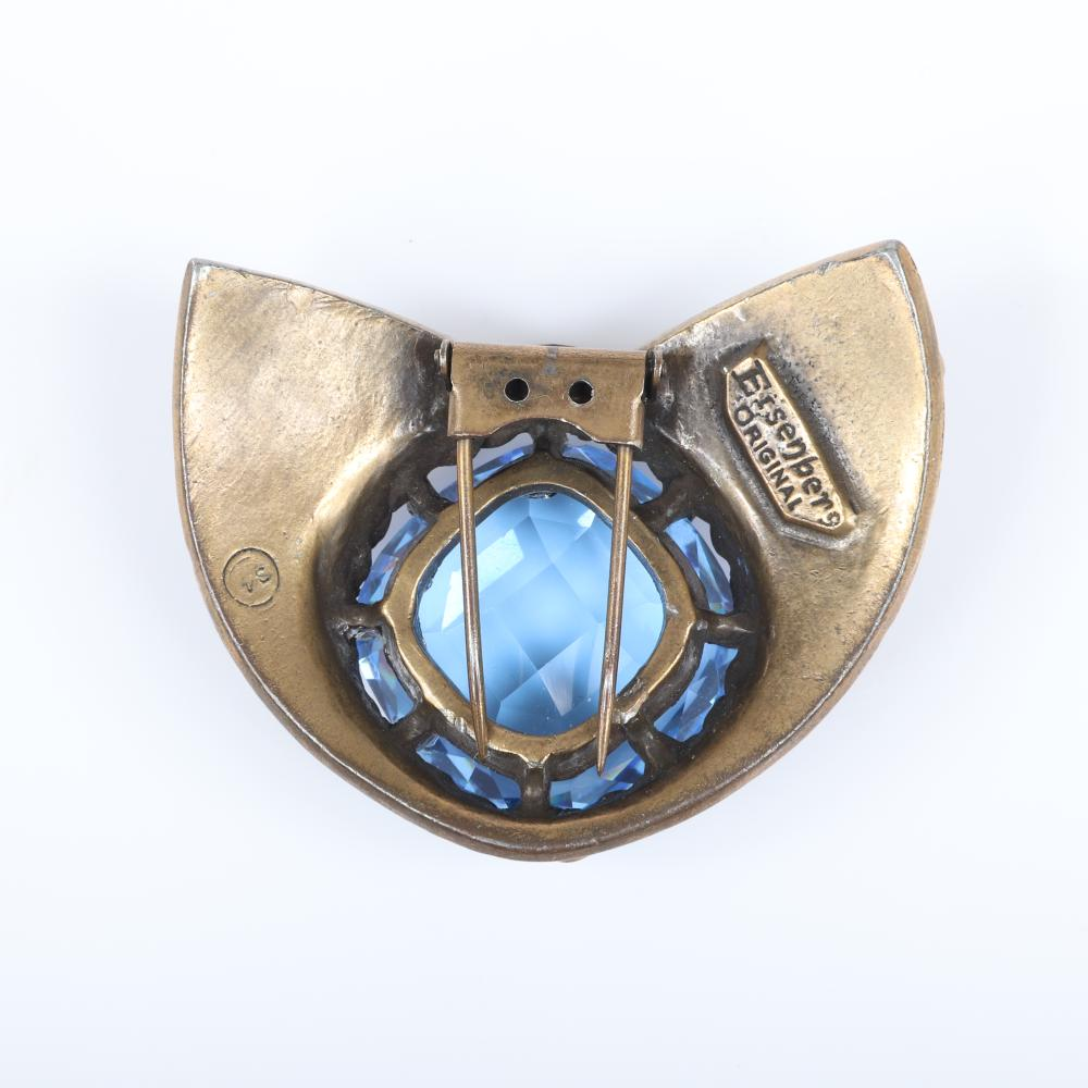 """Eisenberg Original Art Deco fur clip in antiqued gold pot metal accented with black detailing with a large open-backed blue crystal and small faux coral beads, 1930s. 1 1/2"""" x 2 1/2"""""""