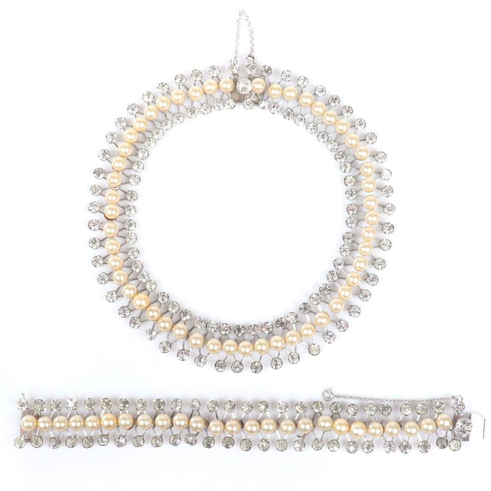 "Eisenberg demi-parure necklace and bracelet in rhodium with ivory faux pearls surrounded by two rows of rhinestones in a crisscross design, 1940s. 15""L (necklace), 7""L (bracelet)"