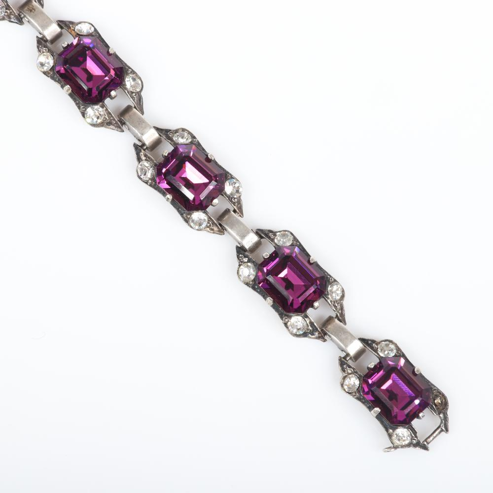 "Eisenberg Original sterling bracelet with seven linked panels, each with a central amethyst emerald-cut crystal surrounded by four bright rhinestones, mid-1940s. 7 5/4""L x 1/2""W"