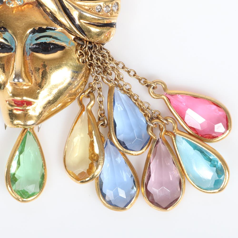 """Eisenberg Original gold plated Sinbad figural fur clip with turbaned head with pave and enamel detailing and multi-colored teardrop framed rhinestone dangles, c. 1940. 3 1/4"""" x 2"""""""