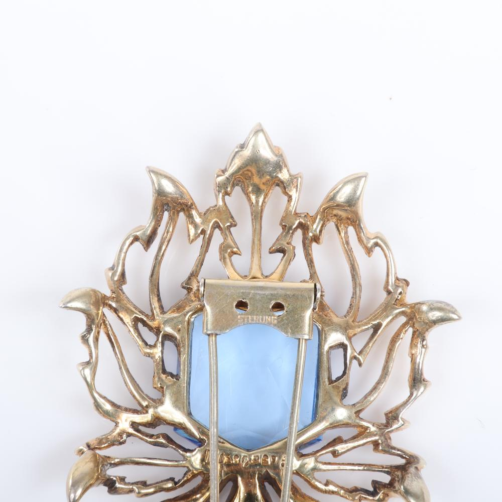 "Eisenberg Original sterling vermeil abstract spider fur clip with dimensional openwork legs, large faceted blue rhinestone body and pave details, mid-1940s. 3"" x 2"""